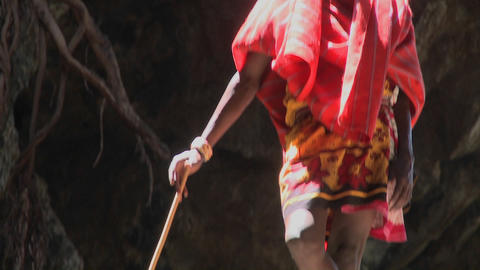 A young Masai boy stands bathed in a pool of light Footage