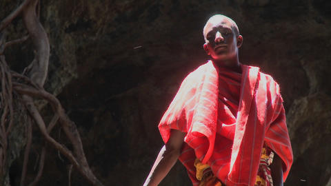A young Masai boy stands bathed in a pool of light Stock Video Footage