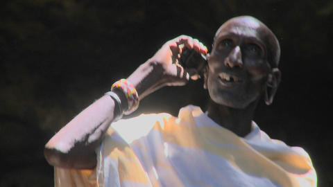 An old Masai warrior speaks on a cell phone Stock Video Footage