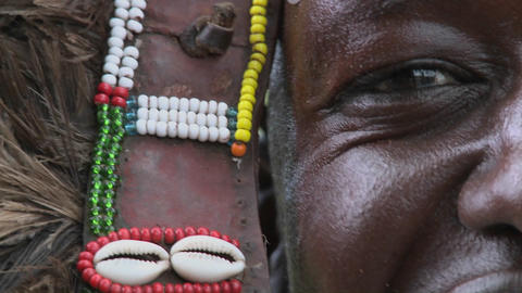 An extreme close up of a Masai warrior in full headdress with d=beads and beadwork Footage
