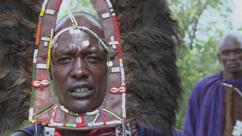 A Masai warrior in full headdress and spear Stock Video Footage