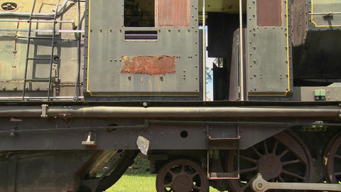 An old train sits rusting in a rail yard Stock Video Footage
