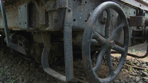 Old rusting parts of a steam train including a handbrake Stock Video Footage