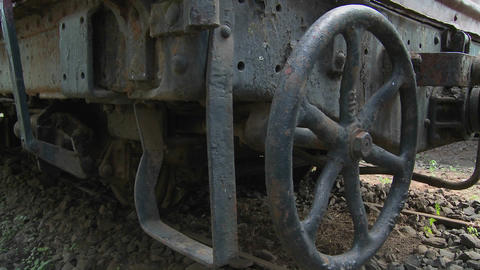 Old rusting parts of a steam train including a handbrake Footage