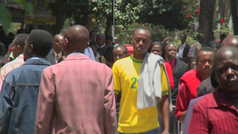 Crowds of Africans walk on the streets of Nairobi, Kenya Stock Video Footage