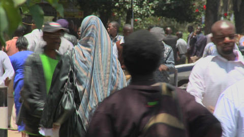 Pedestrians walk on the streets of Nairobi, Kenya Stock Video Footage