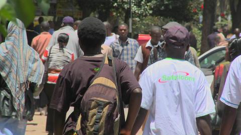 Pedestrians walk on the streets of Nairobi, Kenya Stock Video Footage