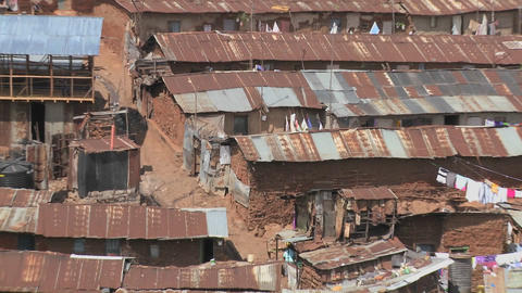 Zoom out from a poverty stricken slum on the outskirts of Nairobi, Kenya Footage