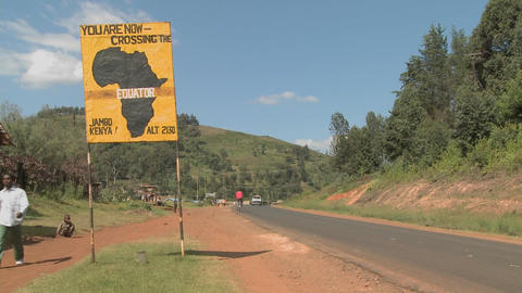 A sign marks the equator line in Kenya, Africa Footage