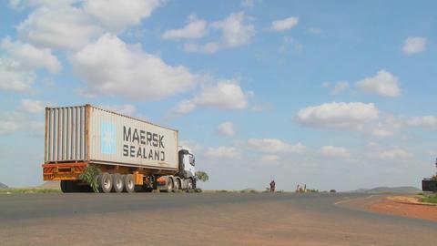 A Maersk Sealand truck sits beside a highway in rural Kenya Stock Video Footage