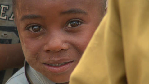 A cute face of a young boy in Africa Stock Video Footage