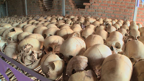 Slow pan across hundreds of skulls in a display in a church remembering the Rwandan holocaust Footage