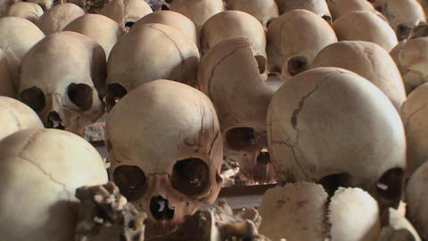 Skulls piled in a display following the genocide in Rwanda Stock Video Footage