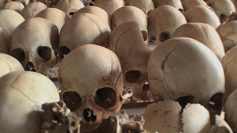 Skulls piled in a display following the genocide in Rwanda Footage