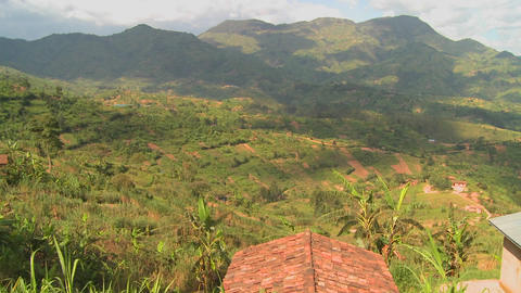 Panning shot across the lush tropical countryside of Rwanda Footage