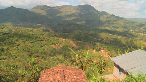 Panning shot across the lush tropical countryside of Rwanda Stock Video Footage