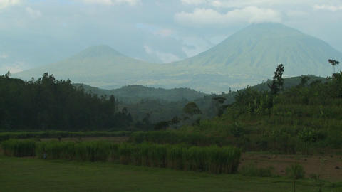 Establishing shot of the Virunga Volcanos on the Rwanda... Stock Video Footage