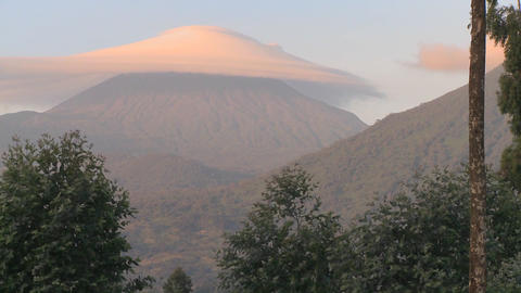 xA strange cloud forms at the summit of the Virunga Volcano chain on the Rwanda Congo border Footage