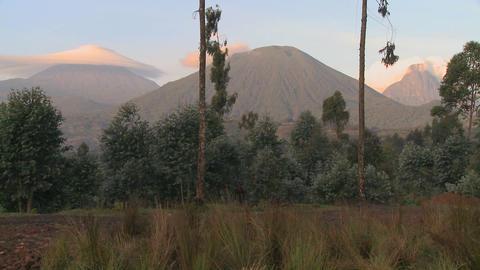 A wide shot of the Virunga volcano chain on the Rwanda Congo border Footage