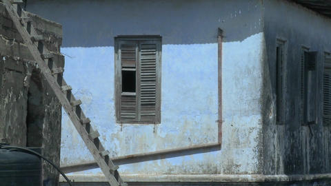 Old decaying buildings line the narrow alleys of Stone Town Zanzibar Live Action