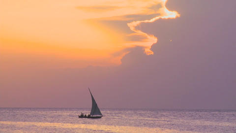 A beautiful dhow sailing boat glides along the coast of... Stock Video Footage