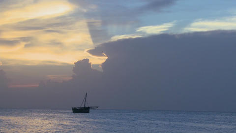 A distant boat sails along the shores of Zanzibar at sunrise Footage