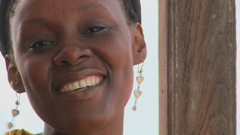 A pretty African woman smiles at the camera Stock Video Footage