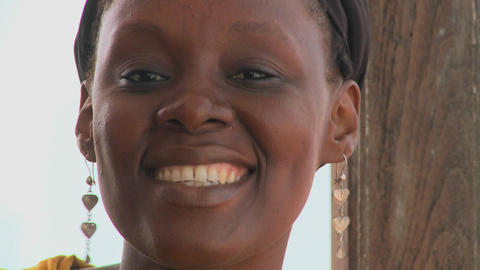 A pretty African woman smiles at the camera Footage