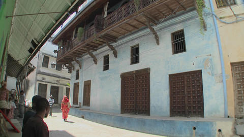 Pedestrians walk in the narrow alleys of Stone Town,... Stock Video Footage