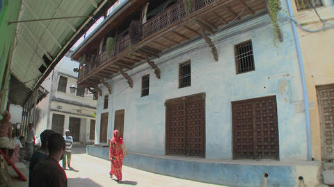 Pedestrians walk in the narrow alleys of Stone Town, Zanzibar Footage