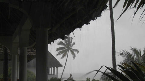 Rain pours down on a tropical beach resort Footage