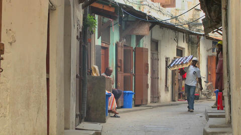 A sunglasses vendor walks on the streets of old Stone... Stock Video Footage