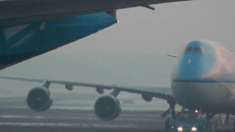 An airplane taxis at a busy airport Stock Video Footage