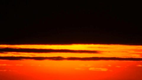 The last rays of sun disappear behind dark clouds Stock Video Footage