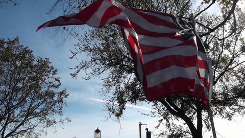 A man holds up an American flag with a peace sign on it... Stock Video Footage