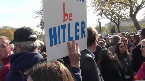 A sign at a political rally says Let Hitler Be Hitler Stock Video Footage
