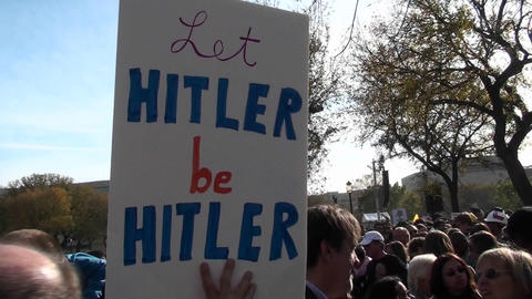 A sign at a political rally says Let Hitler Be Hitler Footage