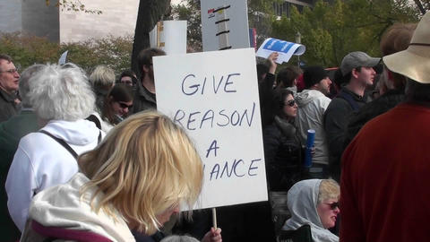 Protestors hold signs at a rally including give reason a... Stock Video Footage