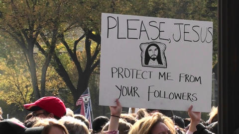 Protestors at a rally hold signs urging Jesus to protect... Stock Video Footage