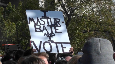 A sign at a rally says I Masturbate and I Vote Footage