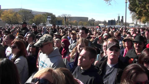 Crowds of protestors on the mall in Washington D.C. jump... Stock Video Footage
