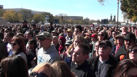 Crowds of protestors on the mall in Washington D.C. jump up and down in unison Footage