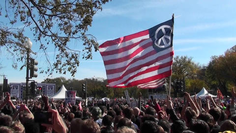 Protestors fly a huge American flag with a peace sign on... Stock Video Footage