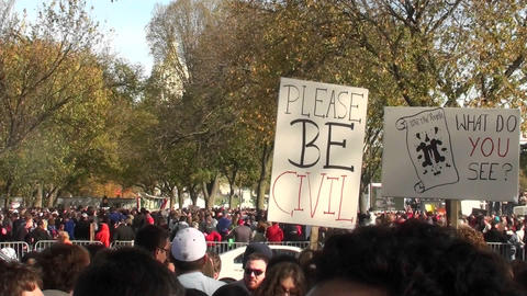 A sign at a political rally implores people to please be... Stock Video Footage