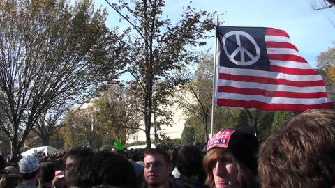 A peace flag flies at a political rally in Washington D.C Stock Video Footage