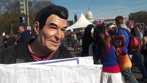 A man in a Ronald Reagan mask urges people to have their... Stock Video Footage
