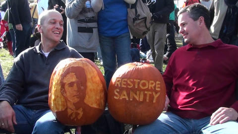 Two guys with carved pumpkins at the Jon Stewart rally to... Stock Video Footage