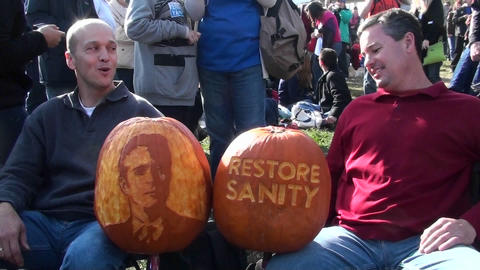 Two guys with carved pumpkins at the Jon Stewart rally to restore sanity Footage