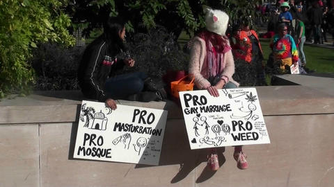 Two girls hold signs announcing they are in favor of... Stock Video Footage