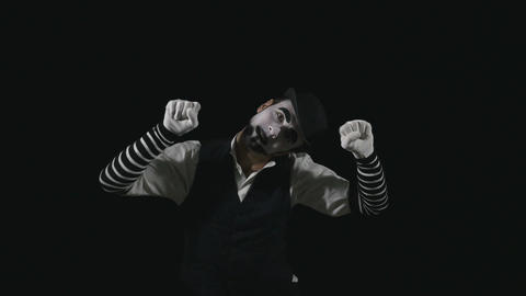 Young funny mime performing a invisible wall act Footage